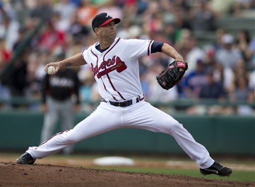Atlanta Braves pitcher Tim Hudson delivers a pitch during the first inning of an exhibition spring training baseball game against the Miami Marlins on Sunday, March 10, 2013, in Kissimmee, Fla. (AP Photo/Evan Vucci)