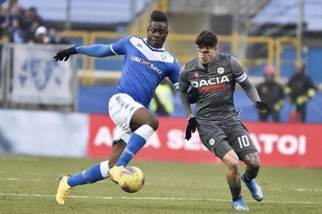 FILE - In this Sunday, Feb. 9, 2020 filer, Udinese's Rodrigo De Paul, right, and Brescia's Mario Balotelli vie for the ball, during a Italian Serie A soccer match at the Mario Rigamonti stadium in Brescia, Italy. Former Italy striker Mario Balotelli was reportedly fired by his hometown club for failing to report for training as the Italian soccer season prepares to resume from a three-month break due to the coronavirus pandemic. (Gianluca Checchi/LaPresse via AP, File )