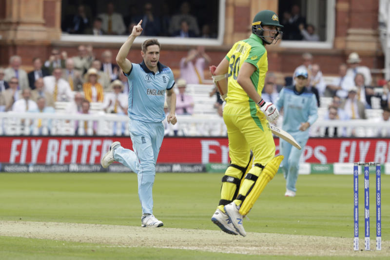England's Chris Woakes celebrates taking the wicket of Australia's Pat Cummins during the Cricket World Cup match between England and Australia at Lord's cricket ground in London, Tuesday, June 25, 2019. (AP Photo/Matt Dunham)