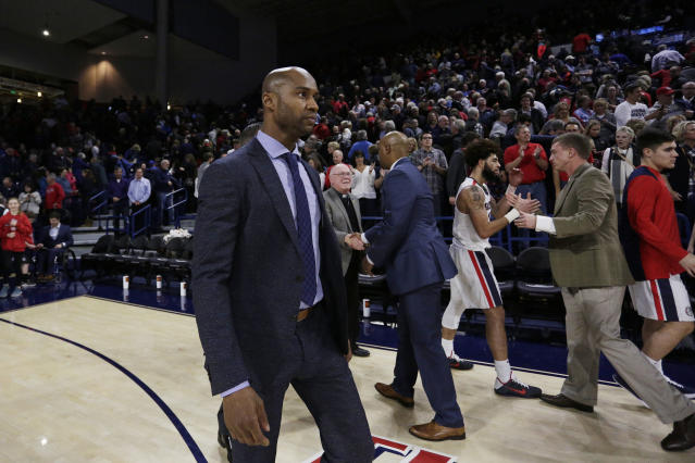 San Diego head coach Lamont Smith walks off the court after an NCAA college basketball game against Gonzaga in Spokane, Wash., Thursday, Feb. 1, 2018. (AP Photo/Young Kwak)