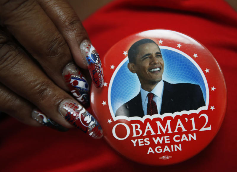 A delegate shows off her President Barack Obama button in the convention hall before the Democratic National Convention in Charlotte, N.C., on Monday, Sept. 3, 2012. (AP Photo/Jae C. Hong)