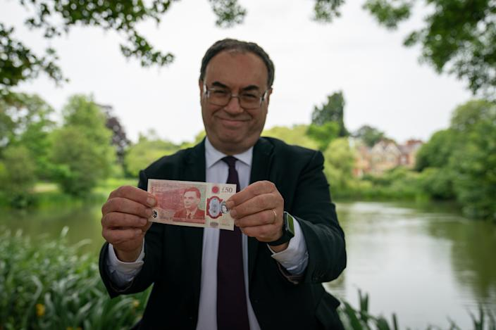 Governor of the Bank of England Andrew Bailey with the new £50 note which features Alan Turing, at Bletchley Park in Milton Keynes, England. Photo: PA