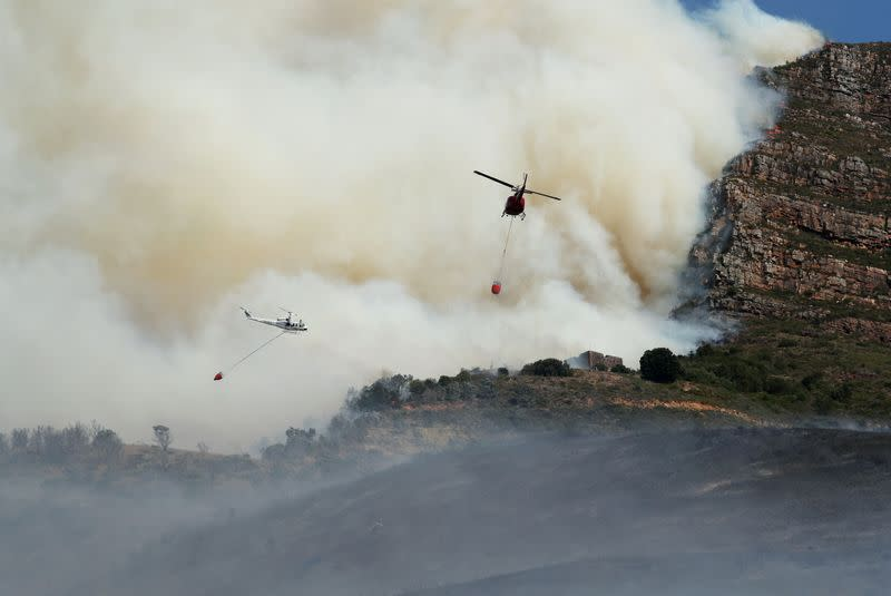 Helicopters battle a bushfire that broke out on the slopes of Table Mountain in Cape Town