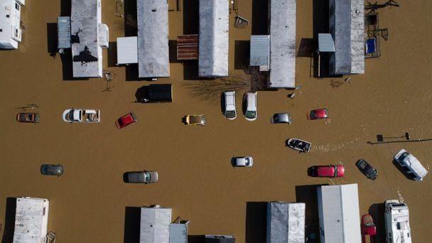 PHOTO: A boat weaves through partially submerged cars and trailers in the city of  following heavy rains which caused the Kentucky River to flood in Beattyville, Ky., March 2, 2021.  (Alex Slitz/AP, FILE)