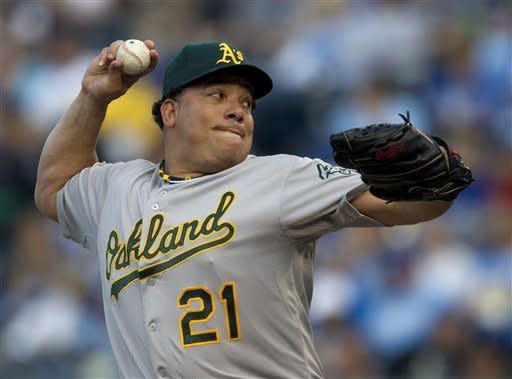 Oakland Athletics starting pitcher Bartolo Colon throws to a Kansas City Royals batter during the first inning of a baseball game in Kansas City, Mo., Friday, June 1, 2012. (AP Photo/Orlin Wagner)