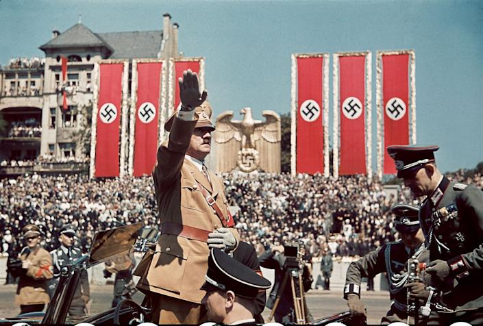 """Adolf Hitler salutes troops of the Condor Legion who fought alongside Spanish Nationalists in the Spanish Civil War, during a rally upon their return to Germany, 1939. (Hugo Jaeger—Time & Life Pictures/Getty Images) <br> <br> <a href=""""http://life.time.com/world-war-ii/nazi-propaganda-and-the-myth-of-aryan-invincibility/#1"""" rel=""""nofollow noopener"""" target=""""_blank"""" data-ylk=""""slk:Click here to see the full collection at LIFE.com"""" class=""""link rapid-noclick-resp"""">Click here to see the full collection at LIFE.com</a>"""