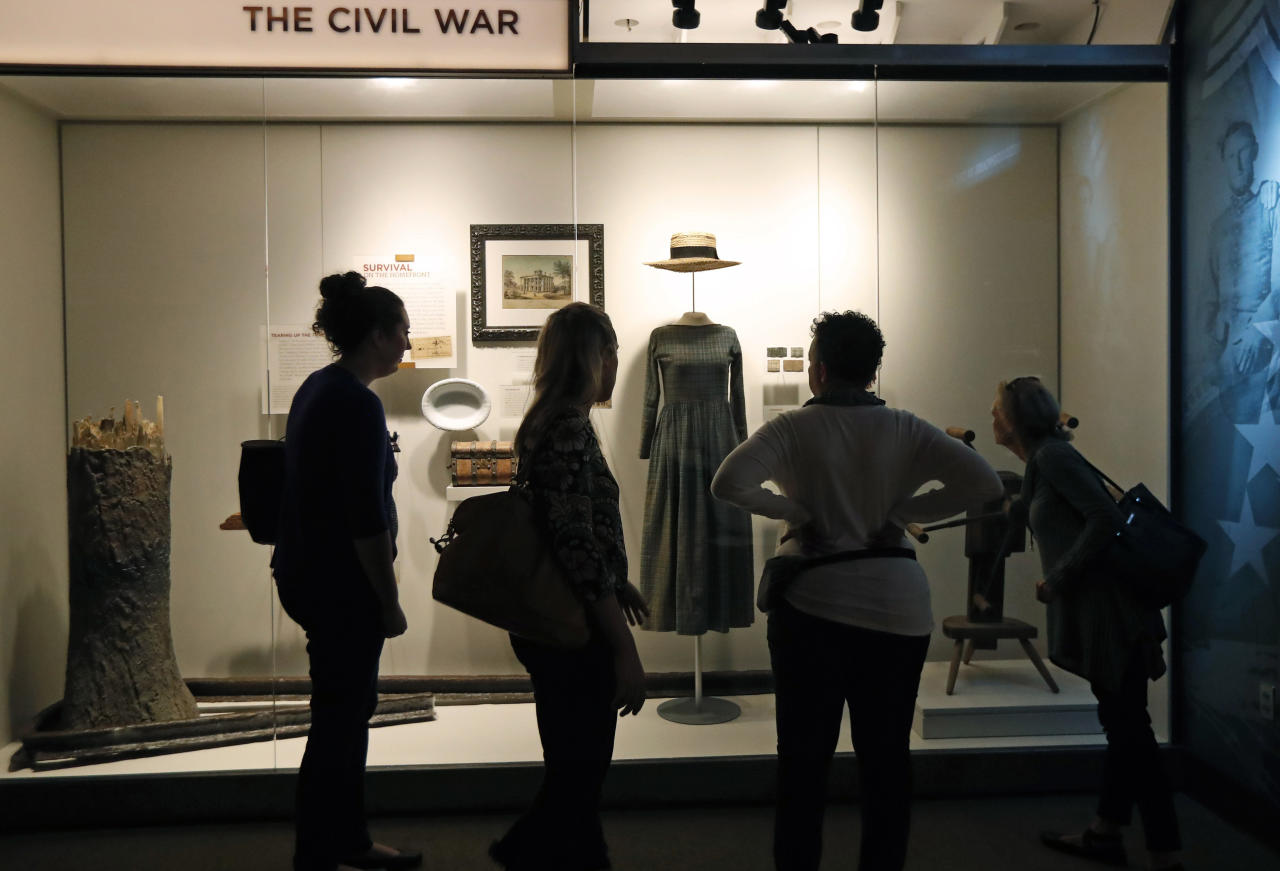 """<p>Visitors to the new Museum of Mississippi History examine examples of clothing in the Civil War gallery during a """"sneak peak"""" for media and invited guests to the state's two new facilities in Jackson, Miss., Tuesday, Nov. 7, 2017. (Photo: Rogelio V. Solis/AP) </p>"""