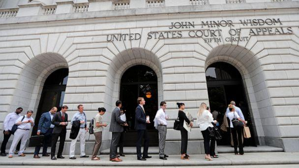 PHOTO: In this Tuesday, July 9, 2019 file photo, People wait in line to enter the 5th Circuit Court of Appeals to sit in overflow rooms to hear arguments in New Orleans. (Gerald Herbert/AP, File)
