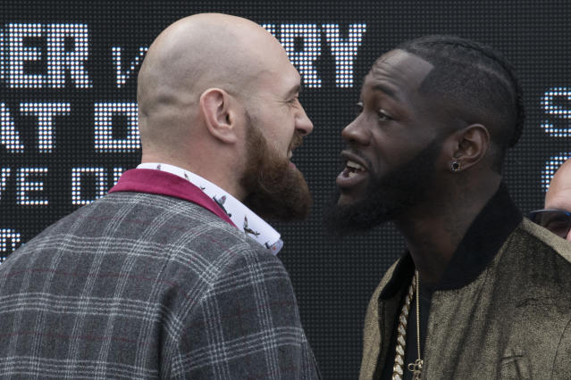 Tyson Fury (L) and Deontay Wilder face off, Tuesday, Oct. 2, 2018, during a boxing news conference in New York. The pair are slated to square off in a world heavyweight title showdown in Los Angeles on Dec, 1. (AP)