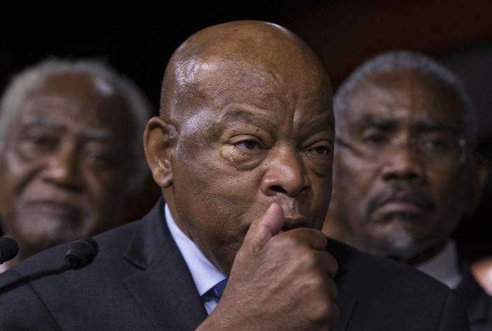 <p>Civil right leader Rep. John Lewis, D-Ga., sheds a tear as he pauses during a news conference with members of the Congressional Black Caucus, on Capitol Hill in Washington, Friday, July 8, 2016, to condemn the the fatal police shootings of black men in Louisiana and Minnesota earlier in the week. At rear are Rep. Danny K. Davis, D-Ill., left, and Rep. Gregory W. Meeks, D-N.Y. (Photo: J. Scott Applewhite/AP) </p>