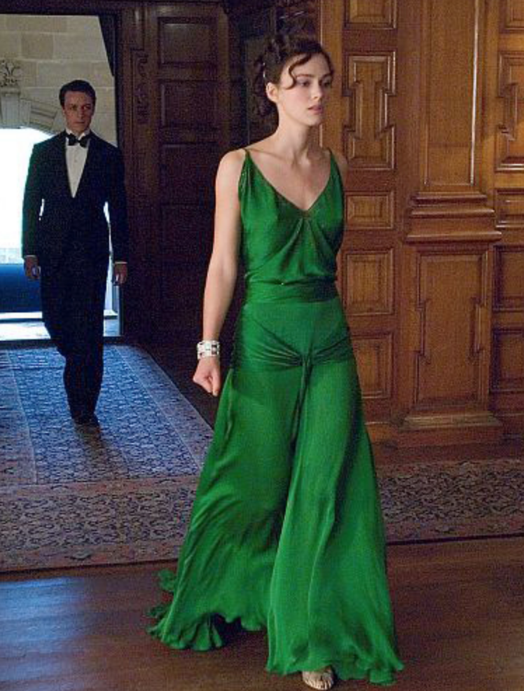 <p>More than a decade after <em>Atonement </em>was released, we still can't stop thinking about Keira Knightley's green dress, designed by Jacqueline Durran. The slinky '30s style and bright jewel tone evokes almost as much drama as the scene it was featured in. </p>