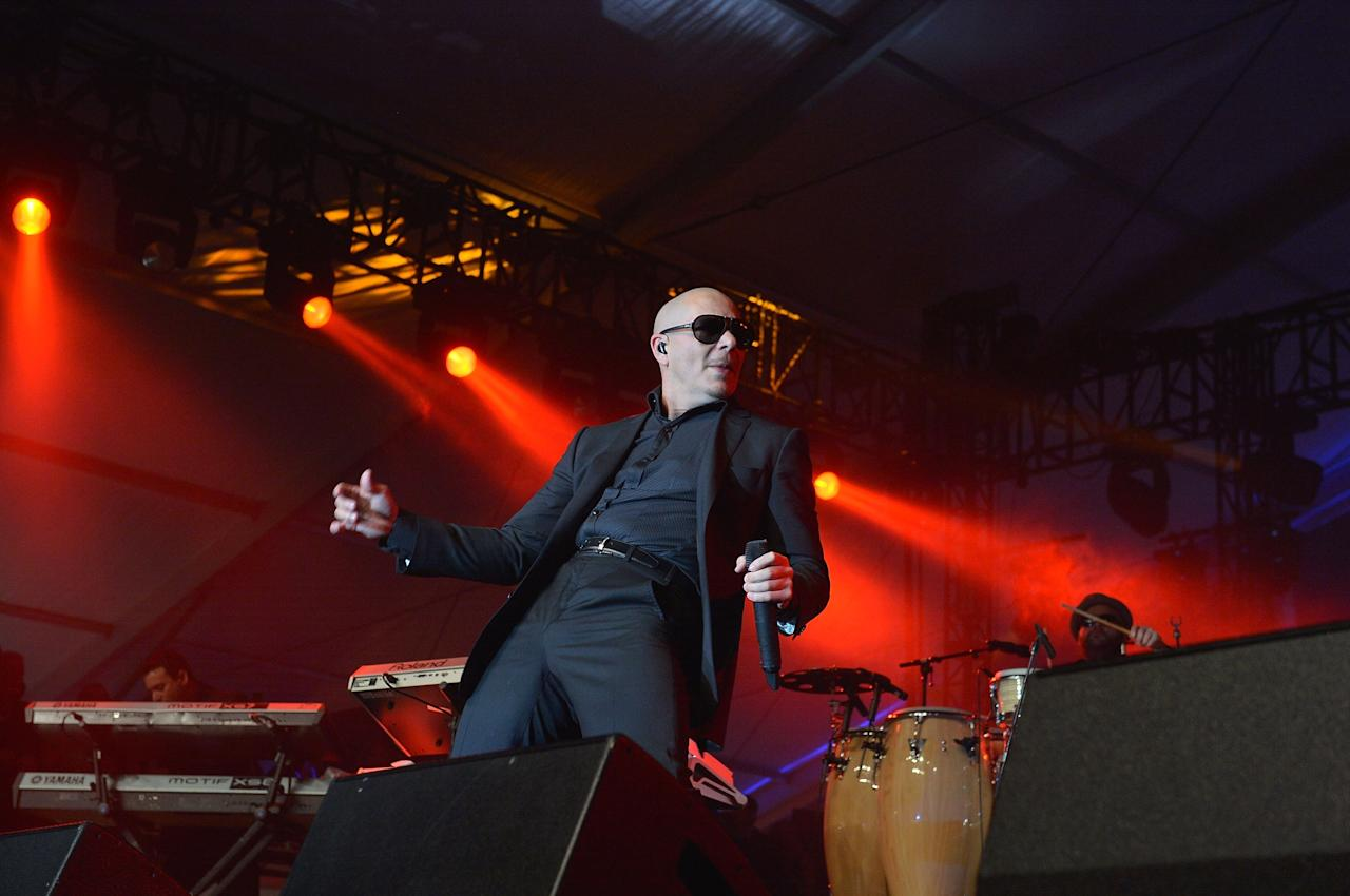 NEW ORLEANS, LA - FEBRUARY 01:  Pit Bull performs at the Rolling Stone LIVE party held at the Bud Light Hotel on February 1, 2013 in New Orleans, Louisiana.  (Photo by Gustavo Caballero/Getty Images for Rolling Stone)