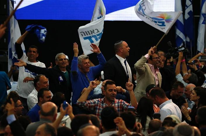 Supporters of Israeli Prime Minister Benjamin Netanyahu's Likud party react to exit poll figures as they wait for the announcement of the first official results of Israel's parliamentary elections on March 17, 2015 (AFP Photo/Jack Guez)