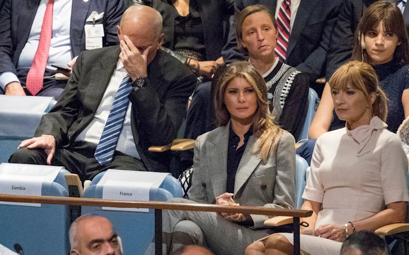 White House Chief of Staff John Kelly, left, reacts as he and first lady Melania Trump listen to U.S. President Donald Trump speak during the 72nd session of the United Nations General Assembly  - AP