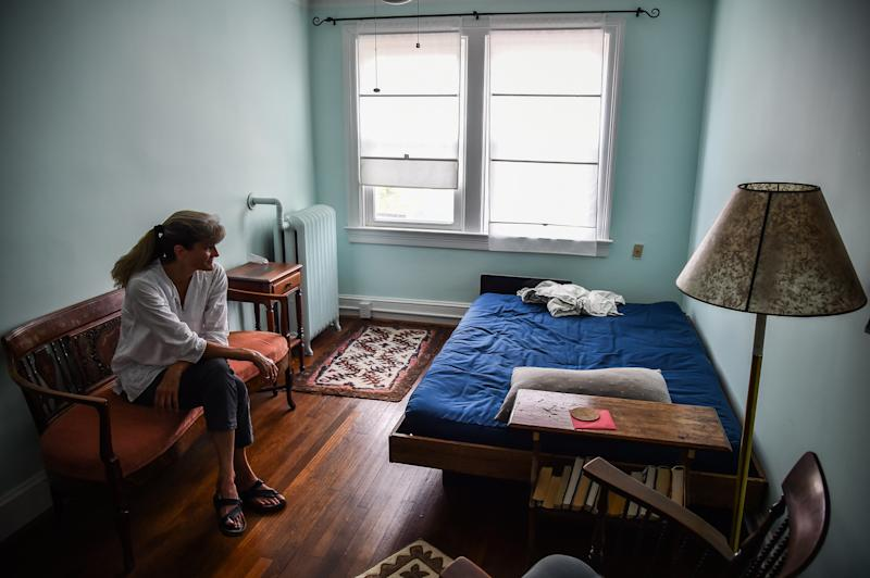 Irene Stevenson, 55, of Washington, D.C., sits in the room that she had prepared for an unaccompanied minor refugee from Africa whom she planned to foster. The travel ban upended the program. (Salwan Georges/The Washington Post via Getty Images)