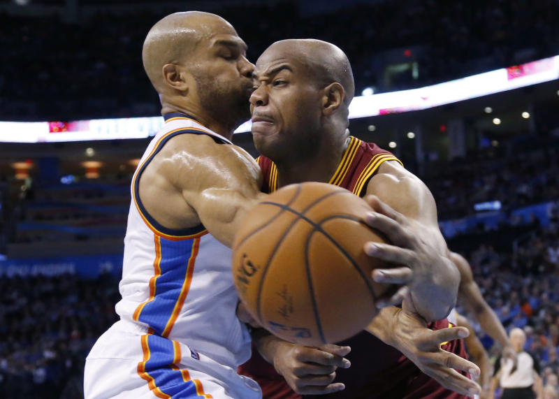 Cleveland Cavaliers guard Jarrett Jack, right, drives past Oklahoma City Thunder guard Derek Fisher during the second quarter of an NBA basketball game in Oklahoma City, Wednesday, Feb. 26, 2014. (AP Photo/Sue Ogrocki)