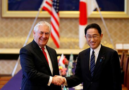 U.S. Secretary of State Tillerson shakes hands with Japan's FM Kishida before their meeting at the foreign ministry's Iikura guest house in Tokyo