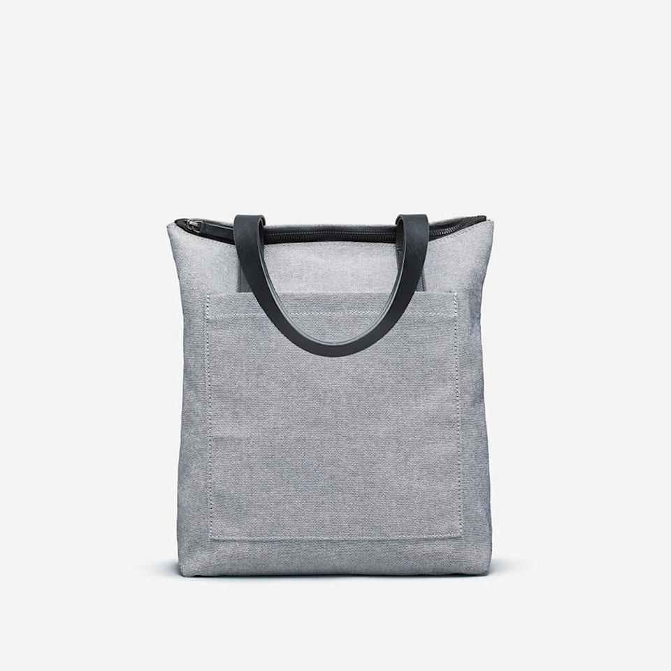 "<p>A versatile tote this sleek seems too good to be under $50. But it is! This twill bag is roomy enough for just about everything, from your laptop to gym clothes.<br><strong><a href=""https://fave.co/2Au8asH"" rel=""nofollow noopener"" target=""_blank"" data-ylk=""slk:SHOP IT"" class=""link rapid-noclick-resp"">SHOP IT</a>:</strong> $48, <a href=""https://fave.co/2Au8asH"" rel=""nofollow noopener"" target=""_blank"" data-ylk=""slk:everlane.com"" class=""link rapid-noclick-resp"">everlane.com</a> </p>"