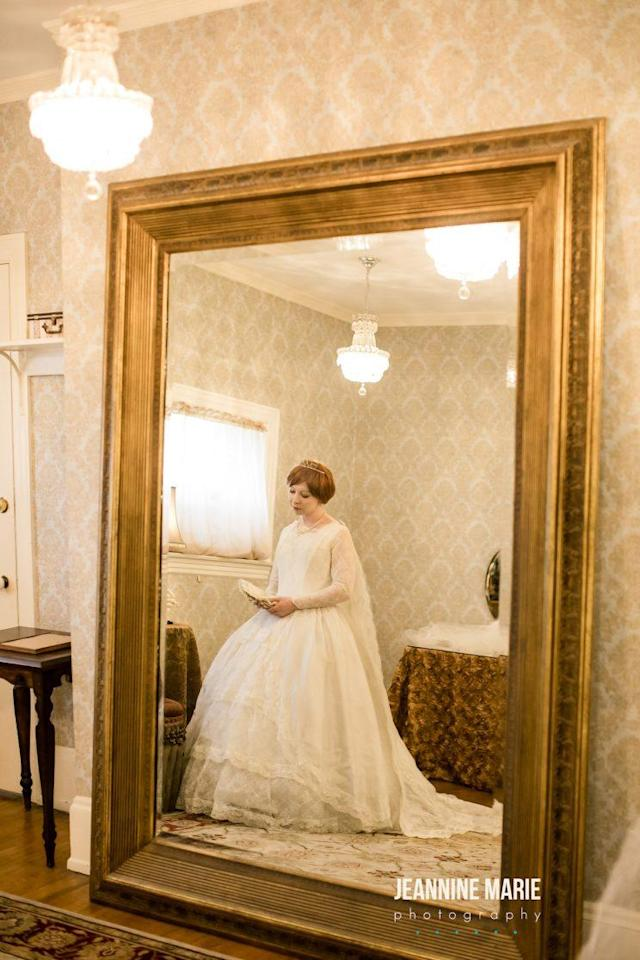 Bride poses in her mother-in-law's wedding dress from 1967.(Photo: Jeannine Marie Photography)