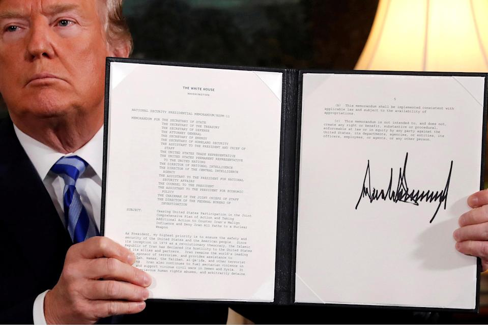 U.S. President Donald Trump holds up a proclamation declaring his intention to withdraw from the JCPOA Iran nuclear agreement. REUTERS/Jonathan Ernst/File Photo