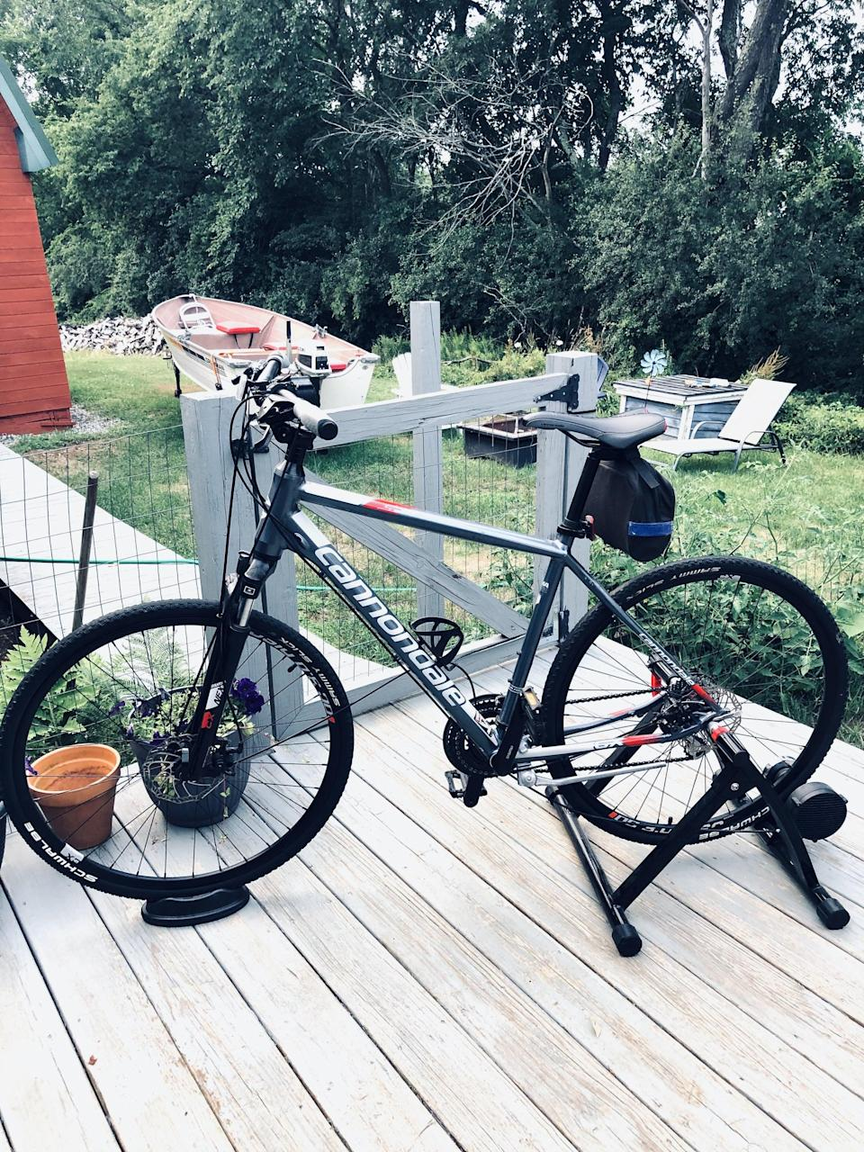"""<p>""""I grew a knack for indoor cycling, so like many of us when stay-at-home orders hit, I was pretty disappointed to miss out on my weekly classes. It wasn't until I moved back home and stumbled across the <span>Sportneer Bike Trainer Stand</span> ($115, originally $130) that I realized I can get a similar workout, affordably. I like this bike stand for many reasons - one being that if you have an outdoor bike, all you have to do is pop it on, lock it, and set your resistance to ride it stationary. And once you're ready for an outdoor ride, you can press down on the clamp in the back and your bike will release and be ready to hit the road."""" - Haley Lyndes, editorial assistant, living</p> <p>Read the full <a href=""""https://www.popsugar.com/fitness/sportneer-bike-trainer-stand-review-47619617"""" class=""""link rapid-noclick-resp"""" rel=""""nofollow noopener"""" target=""""_blank"""" data-ylk=""""slk:Sportneer Bike Trainer Stand review"""">Sportneer Bike Trainer Stand review</a>.</p>"""