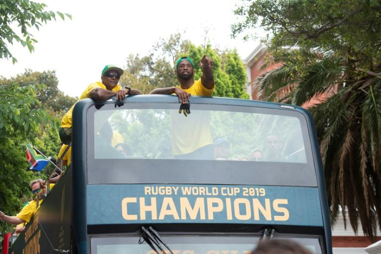 Springbok Captain Siya Kolisi, centre, atop the victory bus. Kolisi rose from extreme poverty to hoist the Rugby World Cup -- an odyssey that has inspired many in South Africa