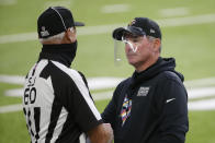 Minnesota Vikings head coach Mike Zimmer talks with side judge Gary Cavaletto, left, before an NFL football game against the Atlanta Falcons, Sunday, Oct. 18, 2020, in Minneapolis. (AP Photo/Bruce Kluckhohn)