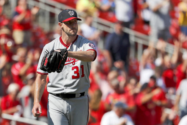 Washington Nationals starting pitcher Max Scherzer reacts after giving up a two-run home run to St. Louis Cardinals' Matt Wieters during the seventh inning of a baseball game Wednesday, Sept. 18, 2019, in St. Louis. (AP Photo/Jeff Roberson)