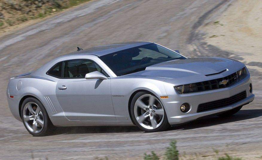 """<p>By 2009, Chevrolet was ready to recognize the error of its ways, and that year it reintroduced the Camaro as a 2010 model. Now based on an Australian Holden chassis with an all-independent suspension, it was offered in base and RS form powered by a 304-hp, 3.6-liter, DOHC 24-valve V-6 or as an SS powered by a 6.2-liter LS-series V-8 rated at a massive 426 horsepower. The major problem with the new car? It was tough to see out of it. """"<a href=""""http://www.caranddriver.com/comparisons/2010-chevy-camaro-ss-vs-2010-ford-mustang-gt-2009-dodge-challenger-r-t-comparison-tests"""" rel=""""nofollow noopener"""" target=""""_blank"""" data-ylk=""""slk:It's not a Camaro unless it can set fire to a burnout box"""" class=""""link rapid-noclick-resp"""">It's not a Camaro unless it can set fire to a burnout box</a>,"""" wrote <em>C/D</em>'s Aaron Robinson. """"Frankly, we expected the 60-mph mark to arrive sooner than 4.8 seconds."""" Oh, how standards had changed.</p>"""