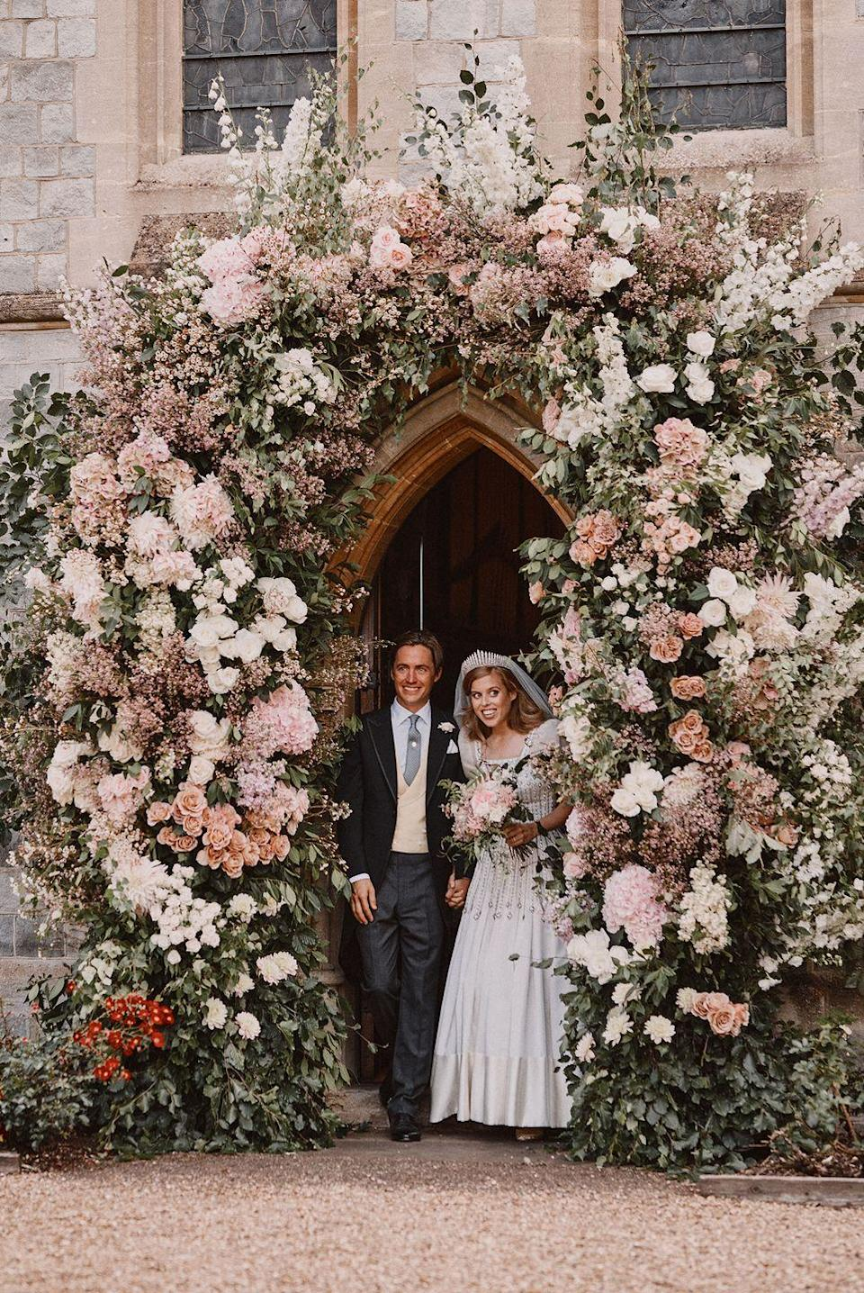 """<p>The couple tied the knot with an intimate wedding ceremony at the <a href=""""https://www.townandcountrymag.com/society/tradition/a33348976/princess-beatrice-edoardo-mapelli-mozzi-wedding-venue-royal-chapel-all-saints/"""" rel=""""nofollow noopener"""" target=""""_blank"""" data-ylk=""""slk:Royal Chapel of All Saints"""" class=""""link rapid-noclick-resp"""">Royal Chapel of All Saints</a> at Royal Lodge, after the coronavirus pandemic put their original wedding plans on pause. The royal wedding was said to have had a <a href=""""https://www.townandcountrymag.com/society/tradition/a33356019/princess-beatrices-royal-wedding-secret-garden-theme/"""" rel=""""nofollow noopener"""" target=""""_blank"""" data-ylk=""""slk:""""secret garden"""" theme"""" class=""""link rapid-noclick-resp"""">""""secret garden"""" theme</a>. Princess Beatrice wore Queen Mary's diamond fringe tiara and<a href=""""https://www.townandcountrymag.com/society/tradition/a31085338/princess-beatrice-wedding-dress/"""" rel=""""nofollow noopener"""" target=""""_blank"""" data-ylk=""""slk:a vintage wedding dress by famed fashion designer Norman Hartness"""" class=""""link rapid-noclick-resp""""> a vintage wedding dress by famed fashion designer Norman Hartness</a>, both of which were on loan to her by the Queen.</p>"""