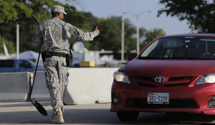 A driver gets the thumbs up at a security checkpoint to enter the Lawrence William Judicial Center as the sentencing phase for Maj. Nidal Hasan continues, Wednesday, Aug. 28, 2013, in Fort Hood, Texas. Hasan was found unanimously guilty on the 13 charges of premeditated murder and is eligible for the death penalty. (AP Photo/Eric Gay)