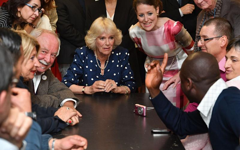 The Duchess of Cornwall (centre) during a visit to the Progetto Arcobaleno Association in in Florence, Italy - Credit: Tim Rooke/PA