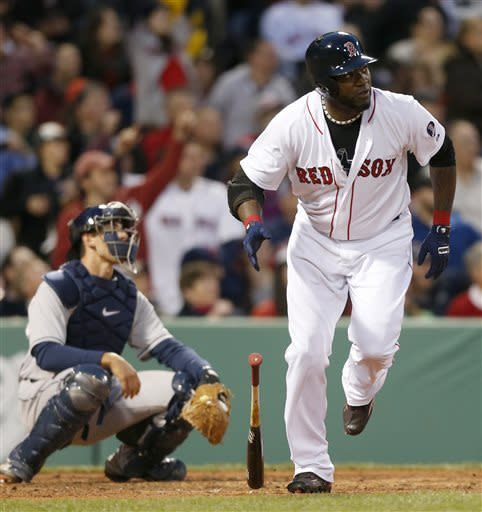 Boston Red Sox's David Ortiz, right, watches his solo home run in front of Houston Astros' Jason Castro in the third inning of a baseball game in Boston, Thursday, April 25, 2013. (AP Photo/Michael Dwyer)