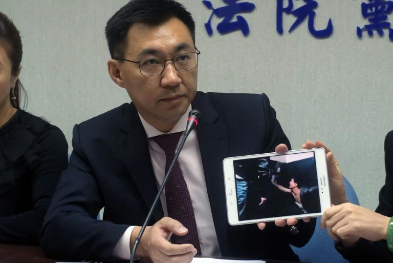 Johnny Chiang, a legislator from the Kuomintang (KMT) party, displays a video showing Taiwanese detented at a police station in Kenya, during a press conference in Taipei, in April 2016