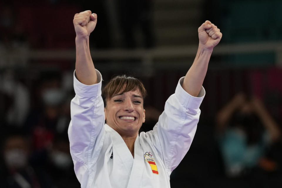 Sandra Sanchez Jaime of Spain celebrates after winning the women's kata final bout for Karate at the 2020 Summer Olympics, Thursday, Aug. 5, 2021, in Tokyo, Japan. (AP Photo/Vincent Thian)