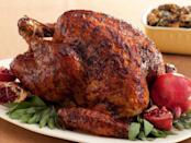 """<p>Leave it to Bobby Flay to come up with a creative, kicky glaze for the big bird made with pomegranate molasses, horseradish, and Dijon mustard. Some chicken stock in the bottom of the pan helps steam the turkey as it roasts. <a href=""""http://www.foodnetwork.com/recipes/bobby-flay/black-pepper-pomegranate-molasses-glazed-turkey-with-wild-rice-goat-cheese-dressing-recipe.html?oc=PTNR-YahooFood-thanksgiving_on_yahoo"""" rel=""""nofollow noopener"""" target=""""_blank"""" data-ylk=""""slk:Get the recipe for Food Network's Black Pepper-Pomegranate Molasses Glazed Turkey here."""" class=""""link rapid-noclick-resp""""><b>Get the recipe for Food Network's Black Pepper-Pomegranate Molasses Glazed Turkey here</b>. </a><i>Photo: Food Network</i><br></p>"""