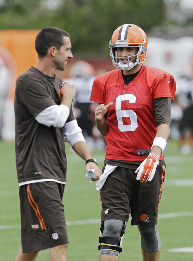 Cleveland Browns quarterback Brian Hoyer (6) talks to offensive coordinator Kyle Shanahan during practice at the NFL football team's facility in Berea, Ohio Wednesday, Aug. 20, 2014. Earlier Hoyer was named the regular season starter by head coach Mike Pettine. (AP Photo/Mark Duncan)