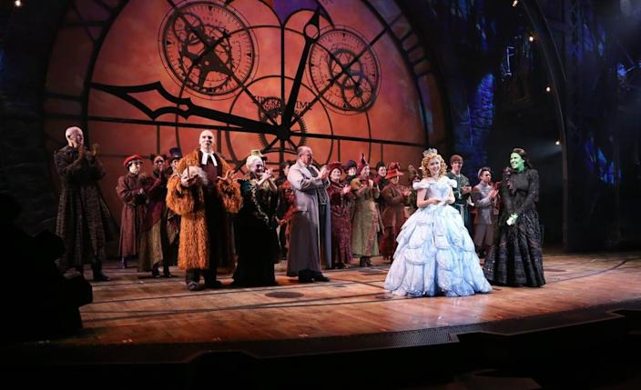 """<div class=""""inline-image__caption""""> <p>Leads Alli Mauzey (L) and Lindsay Mendez with cast attend """"Wicked"""" Celebrates 10th Anniversary on Broadway at Gershwin Theatre on October 30, 2013 in New York City.</p> </div> <div class=""""inline-image__credit""""> Rob Kim/Getty </div>"""