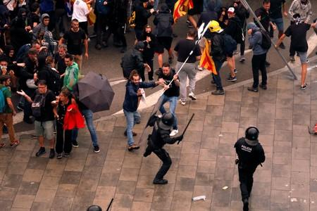 Protesters clash with police during a demonstration at Barcelona's airport, after a verdict in a trial over a banned independence referendum