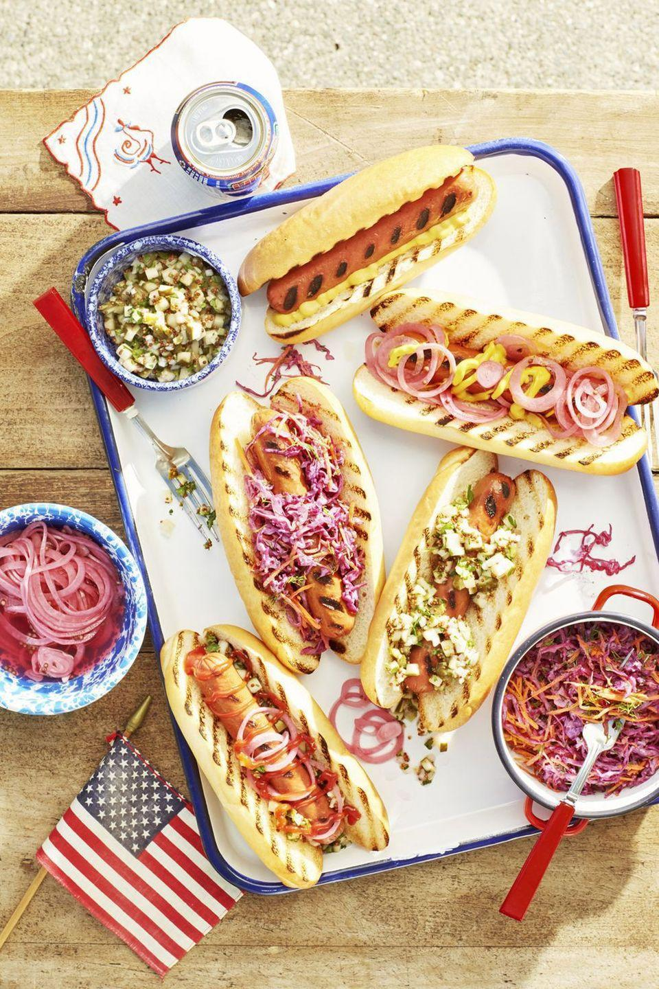"<p>Pickles and onions, tangy horseradish, or spicy chiles: Which fixin' will be your favorite? (Good news: You can try all three!)</p><p><strong><a href=""https://www.countryliving.com/food-drinks/a21347552/grilled-hotdogs-recipe/"" rel=""nofollow noopener"" target=""_blank"" data-ylk=""slk:Get the recipe"" class=""link rapid-noclick-resp"">Get the recipe</a>.</strong></p><p><strong><a class=""link rapid-noclick-resp"" href=""https://www.amazon.com/Weber-7429-Rapid-Chimney-Starter/dp/B07B5BHKDZ/?tag=syn-yahoo-20&ascsubtag=%5Bartid%7C10050.g.3663%5Bsrc%7Cyahoo-us"" rel=""nofollow noopener"" target=""_blank"" data-ylk=""slk:SHOP CHIMNEY STARTERS"">SHOP CHIMNEY STARTERS</a></strong></p>"