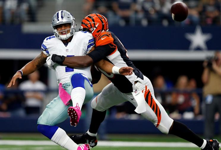 Dak Prescott #4 of the Dallas Cowboys is pressured by Carlos Dunlap #96 of the Cincinnati Bengals during the second quarter at AT&T Stadium on October 9, 2016 in Arlington, Texas. (Photo by Wesley Hitt/Getty Images)
