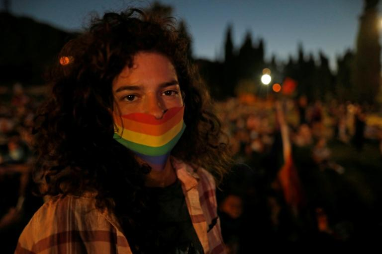 A participant wearing a rainbow-themed mask at the annual Jerusalem Pride parade amid the COVID-19 pandemic (AFP Photo/MENAHEM KAHANA)