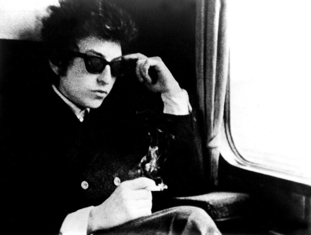 """<a href=""""http://movies.yahoo.com/movie/1800350352/info"""">Don't Look Back</a> (1967): A classic from legendary documentarian D.A. Pennebaker, this behind-the-scenes look at the 23-year-old Dylan set the standard for this kind of film. It's got all that famous imagery: the black-and-white verite photography, Dylan standing there tossing away cue cards with the lyrics to """"Subterranean Homesick Blues."""" All impish charisma and childish impulse, Dylan tours England in 1965 with Joan Baez and Donovan, tussles with reporters and forges one of the many facets of his persona we'd come to know, or at least think we know. """"Walk Hard: The Dewey Cox Story"""" parodies this time in Dylan's life with dead-on hilarity."""
