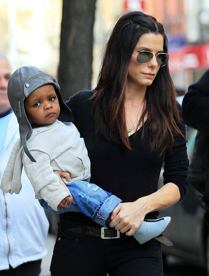 """Does it get much cuter than this? Sandra Bullock was spotted out and about in New York City over the weekend with her 15-month-old little man, Louis Bardo, who looked ready to jet in his adorable aviator hat. Jackson Lee/<a href=""""http://www.splashnewsonline.com"""" target=""""new"""">Splash News</a> - April 9, 2011"""