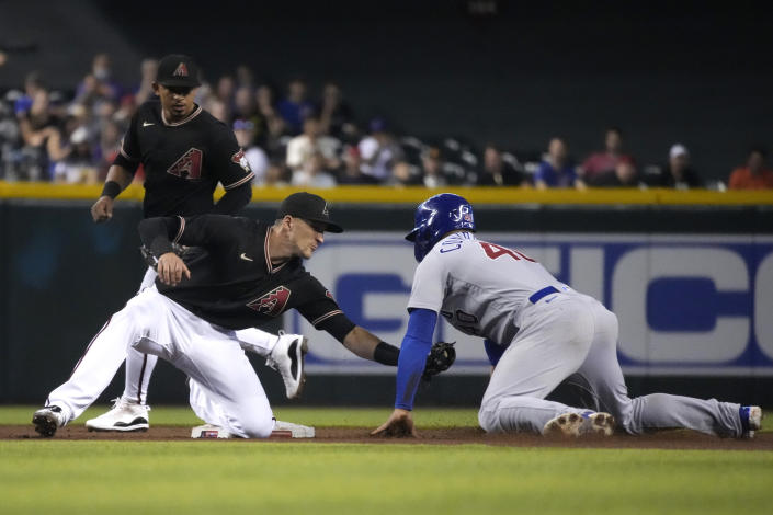 Chicago Cubs' Willson Contreras (40) gets tagged out by Arizona Diamondbacks shortstop Nick Ahmed, left, while trying to steal second base in the third inning during a baseball game, Saturday, July 17, 2021, in Phoenix. (AP Photo/Rick Scuteri)