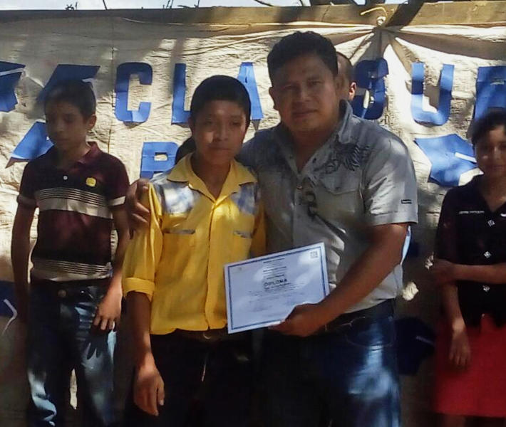 In this Oct. 31, 2018 photo released by Jimmy Cristian Gutierrez Garcia, the teacher of child migrant Juan de Leon Gutiérrez, shows Juan posing with his teacher Jimmy during a school contest in El Tesoro village, Camotan, Guatemala. The 16-year-old died on April 30 after officials at a South Texas youth detention facility noticed he was sick, becoming the third Guatemalan child to die in U.S. custody since December. (Jimmy Cristian Gutierrez Garcia via AP)