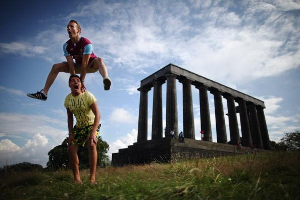 Members of the InSTEP theatre group take part in a photocall on Calton Hill to promote their show at the Edinburgh Fringe, 'Departure Lounge,' on August 6, 2012 in Edinburgh, Scotland. The Edinburgh Festival Fringe is the largest arts festivals in the world, it was established as an alternative to the International Festival also held in August, and celebrates it's 66th anniversary this year. (Photo by Dan Kitwood/Getty Images)