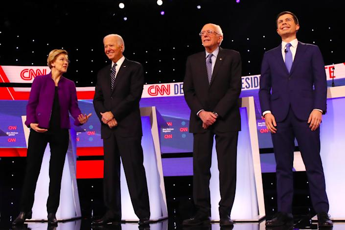 Elizabeth Warren, Joe Biden, Bernie Sanders and Pete Buttigieg take the stage before the Democratic primary debate in Des Moines, Iowa, on Tuesday. (Photo: Spencer Platt/Getty Images)