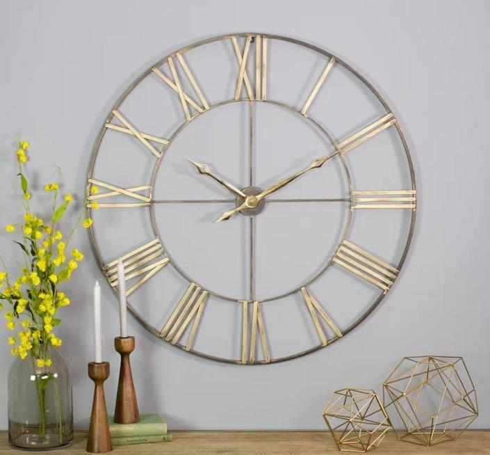 """This oversized wall clock is a stunning addition to any bare wall. It's crafted out of iron and measures 40 inches in diameter. $199, Wayfair. <a href=""""https://www.wayfair.com/decor-pillows/pdp/gracie-oaks-oversized-mosher-40-wall-clock-ehq4306.html"""" rel=""""nofollow noopener"""" target=""""_blank"""" data-ylk=""""slk:Get it now!"""" class=""""link rapid-noclick-resp"""">Get it now!</a>"""