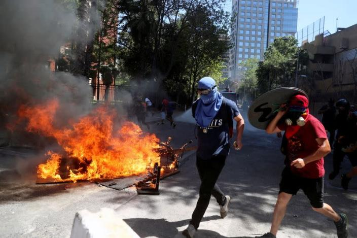 Protest against Chile's government during the one-year anniversary in Santiago of the protests and riots in 2019